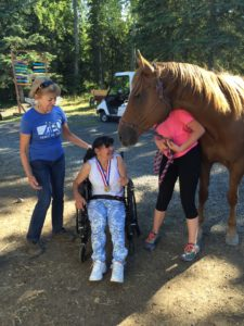Penny and one of our long-time riders getting some much needed hugs in!